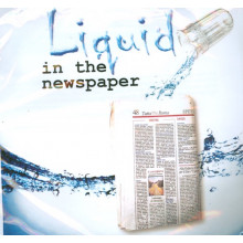 Liquid in the Newspaper